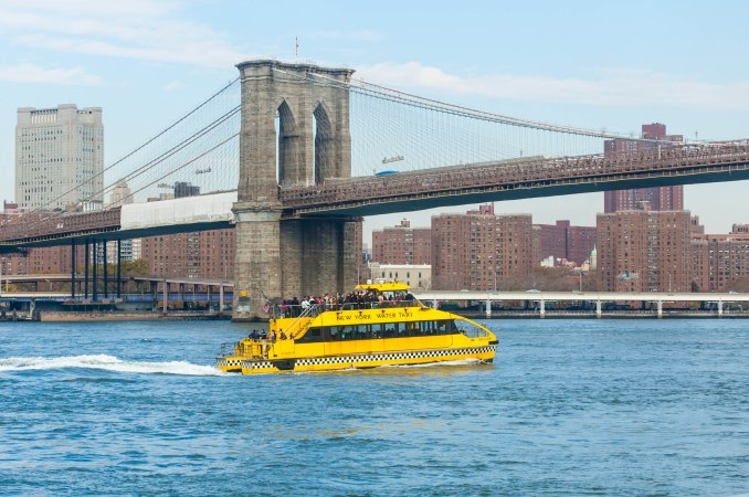 Water taxi approaching the Brooklyn Bridge